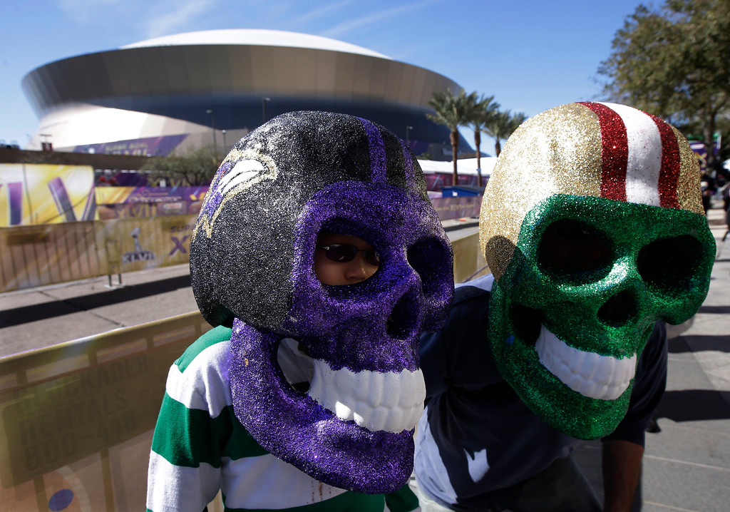 Description of . David and Evan Waksman, from New York, pose with skull helmets outside the Superdome before the NFL Super Bowl XLVII football game between the San Francisco 49ers and the Baltimore Ravens Sunday, Feb. 3, 2013, in New Orleans. (AP Photo/Mark Humphrey)