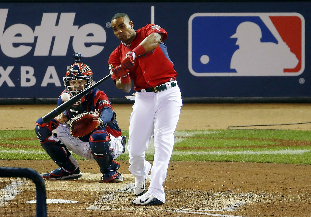 Description of . American League's Yoenis Cespedes, of the Oakland Athletics, hits during the MLB All-Star baseball Home Run Derby, Monday, July 14, 2014, in Minneapolis. (AP Photo/Paul Sancya)