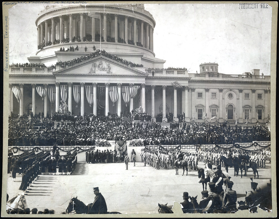 Description of . Chief Justice Melville W. Fuller administering the oath of office to Theodore Roosevelt on the east portico of the U.S. Capitol. (Photo from The Library of Congress)