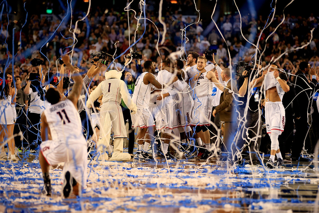 Description of . ARLINGTON, TX - APRIL 07:  The Connecticut Huskies celebrate after defeating the Kentucky Wildcats 60-54 in the NCAA Men\'s Final Four Championship at AT&T Stadium on April 7, 2014 in Arlington, Texas.  (Photo by Jamie Squire/Getty Images)