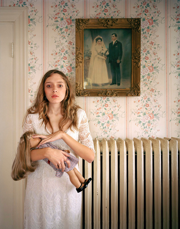 Description of . Ilona Szwarc of Poland, a photographer working for Redux Images, has won the third prize in the People - Observed Portraits Single category of the World Press Photo Contest 2013 with this picture of Kayla posing with her lookalike doll in front of a portrait of her ancestors in Boston, Massachusetts, taken on February 19, 2012 and distributed by the World Press Photo Foundation February 15, 2013.   REUTERS/Ilona Szwarc/Redux Images/World Press Photo/Handout