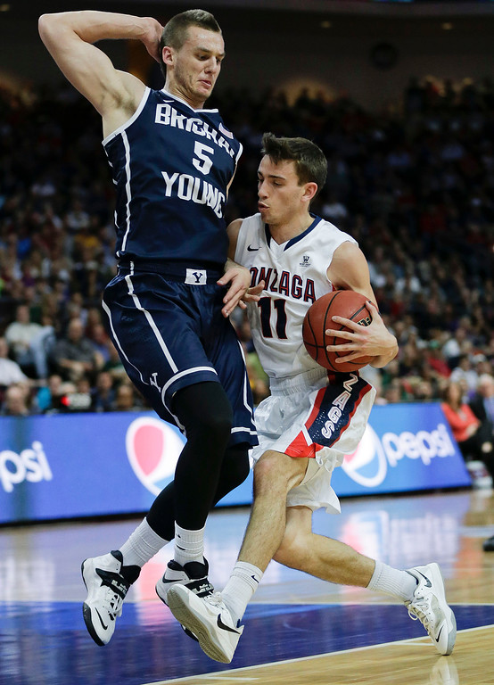 Description of . Gonzaga's David Stockton (11) drives against BYU's Kyle Collinsworth (5) in the first half of the NCAA West Coast Conference tournament championship college basketball game, Tuesday, March 11, 2014, in Las Vegas. (AP Photo/Julie Jacobson)