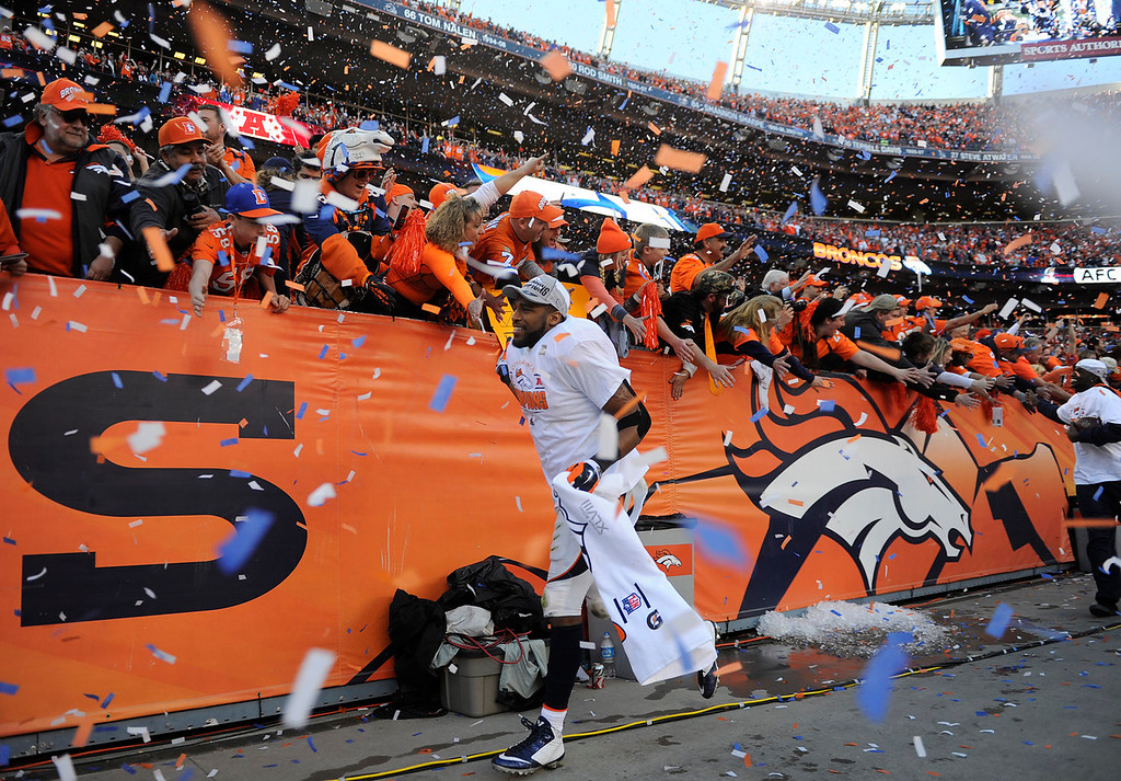 Description of . Denver Broncos middle linebacker Wesley Woodyard (52) high-fives the fans after the game. The Denver Broncos take on the New England Patriots in the AFC Championship game at Sports Authority Field at Mile High in Denver on January 19, 2014. (Photo by AAron Ontiveroz/The Denver Post)