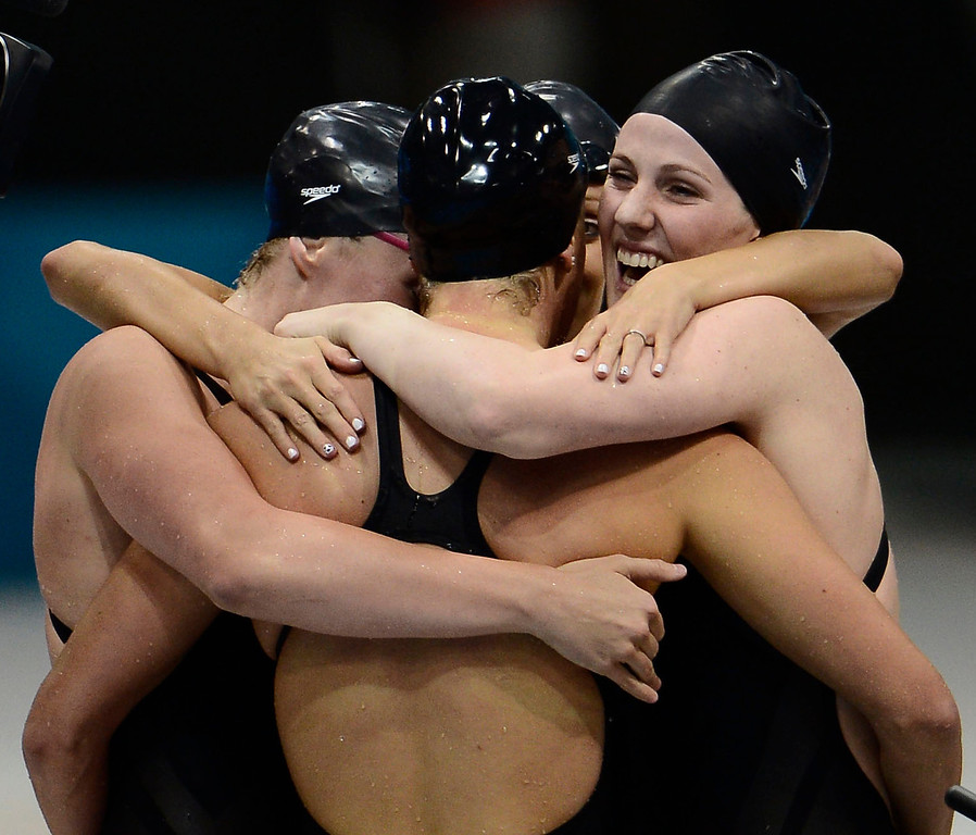 Description of . Shannon Vreeland, Dana Volmer and Missy Franklin surround Allison Schmitt as the celebrate their win the women's 4 x 200m freestyle relay during the London 2012 Sumer Games. The team posted an Olympic Record with a time of 7:42.92 to capture the gold medal  John Leyba, The Denver Post