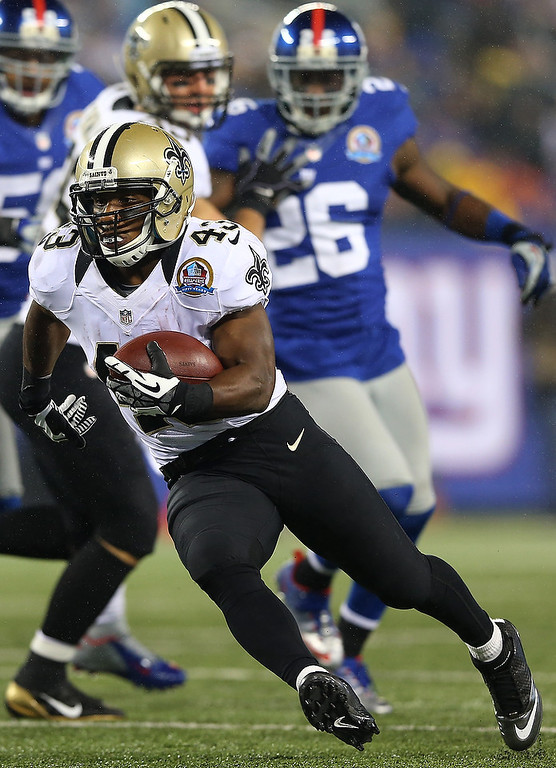 Description of . Darren Sproles #43 of the New Orleans Saints carries the ball in for a touchdown against the New York Giants on December 9, 2012 at MetLife Stadium in East Rutherford, New Jersey.  (Photo by Elsa/Getty Images)