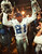 TEMPE, AZ - JANUARY 28:  Dallas Cowboys cornerback Deion Sanders hoists the Vince Lombardi Super Bowl trophy as he walks off the field to the locker room after defeating the Pittsburgh Steelers 28 January during Super Bowl XXX at Sun Devil Stadium in Tempe, Arizona. The Cowboys won 27-17. VINCE BUCCI/AFP/Getty Images