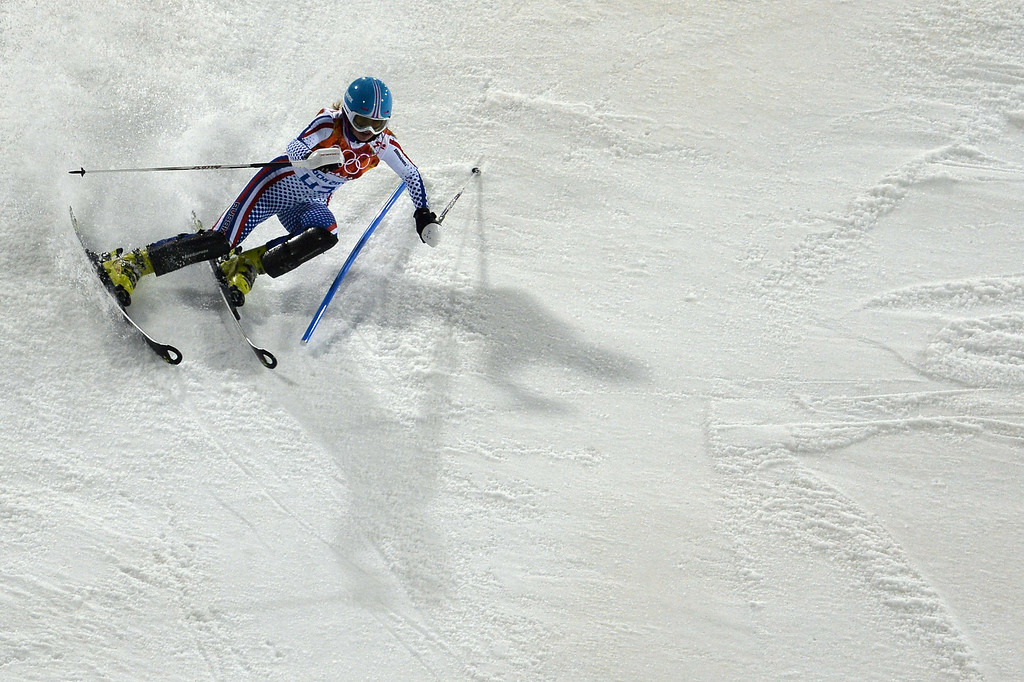 Description of . Russia's Ksenia Alopina competes during the Women's Alpine Skiing Slalom Run 2 at the Rosa Khutor Alpine Center during the Sochi Winter Olympics on February 21, 2014.   AFP PHOTO / DIMITAR DILKOFF/AFP/Getty Images