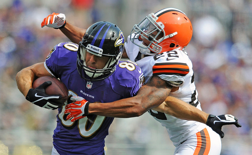 Description of . Cleveland Browns cornerback Buster Skrine, right, wraps up Baltimore Ravens tight end Dennis Pitta during the second half of an NFL football game in Baltimore, Md., Sunday, Sept. 15, 2013. (AP Photo/Gail Burton)