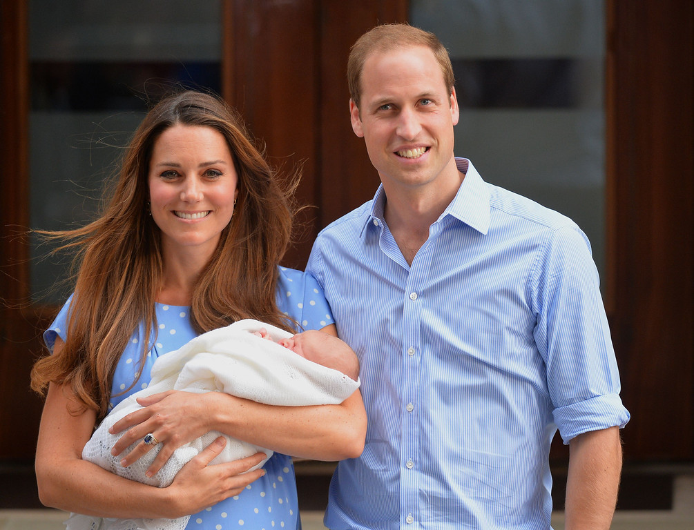 Description of . Prince William and Catherine, Duchess of Cambridge, show their newborn baby boy to the world's media, while standing on the steps outside   St Mary's Hospital in London on July 23, 2013. The baby was born on Monday afternoon weighing eight pounds six ounces (3.8 kilogrammes). The baby, titled His Royal Highness, Prince of Cambridge, is directly in line to inherit the throne after Charles, Queen Elizabeth II's eldest son and heir, and his eldest son William.   LEON NEAL AFP/Getty Images