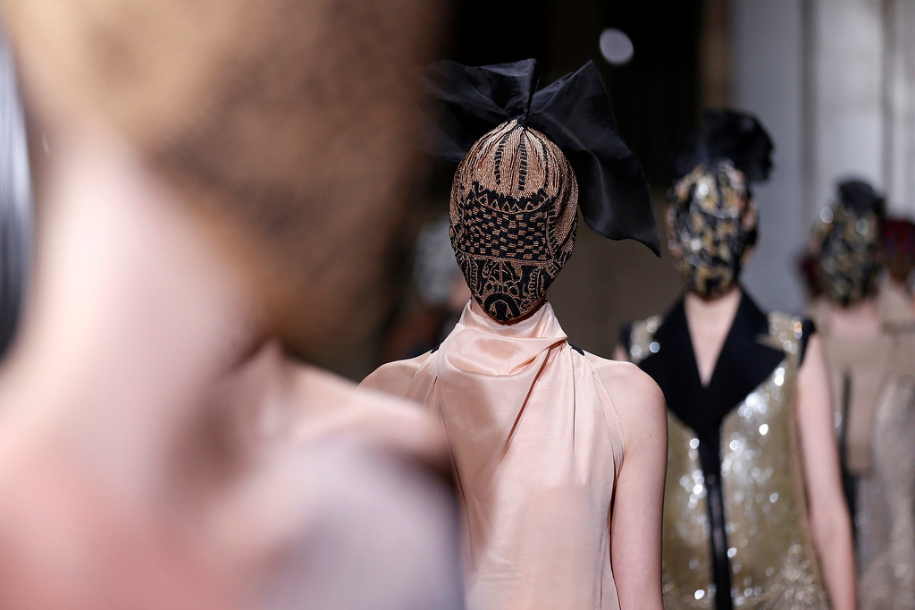 Description of . A model presents a creation for Belgian fashion house Maison Martin Margiela as part of its Haute Couture Spring-Summer 2013 fashion show in Paris January 23, 2013. REUTERS/Benoit Tessier