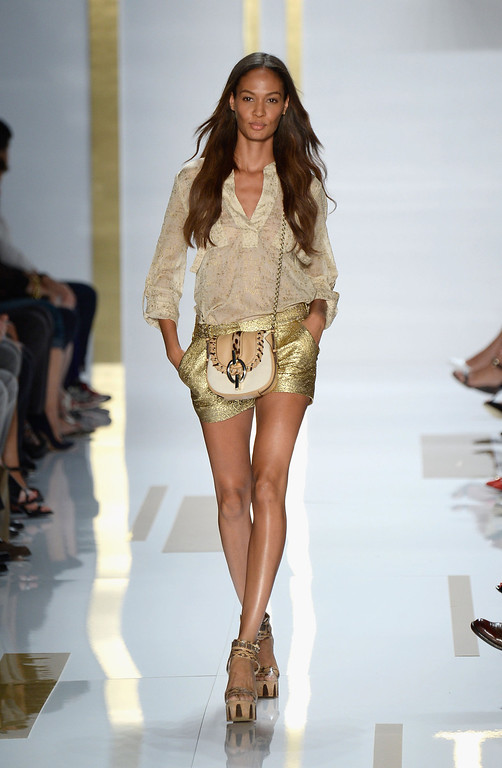 Description of . Model Joan Smalls walks the runway at the Diane Von Furstenberg fashion show during Mercedes-Benz Fashion Week Spring 2014 at The Theatre at Lincoln Center on September 8, 2013 in New York City.  (Photo by Frazer Harrison/Getty Images for Mercedes-Benz Fashion Week Spring 2014)