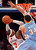 New York Knicks' Carmelo Anthony (7) shoots against Denver Nuggets' JaVale McGee (34) during an NBA basketball game, Sunday, Dec. 9, 2012, in New York.  New York beat Denver, 112-106. (AP Photo/Jason DeCrow)