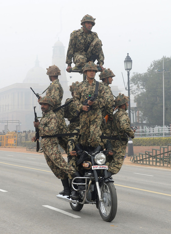 Description of . Indian Border Security Force (BSF) soldiers perform a motorcycle stunt during a rehearsal for India's upcoming Republic Day parade in New Delhi on January 20, 2012. The country wide preparations are picking up to celebrate India's transition to a Republic on  January 26, 1950.  AFP PHOTO/RAVEENDRAN