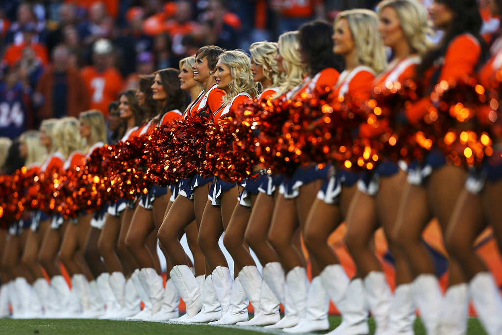 Description of . The Denver Broncos cheerleaders perform against the Oakland Raiders at Sports Authority Field at Mile High on September 23, 2013 in Denver, Colorado.  (Photo by Justin Edmonds/Getty Images)