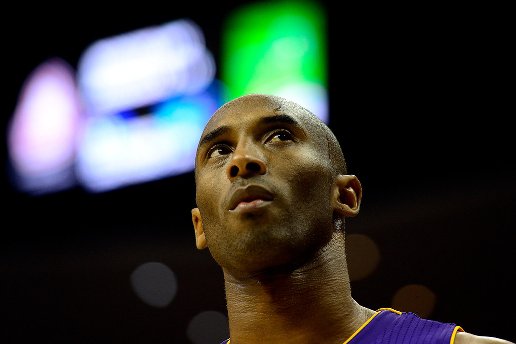Description of . Los Angeles Lakers shooting guard Kobe Bryant (24) takes a breather against the Denver Nuggets during the second half of the Nuggets' 126-114 win at the Pepsi Center on Wednesday, December 26, 2012. AAron Ontiveroz, The Denver Post