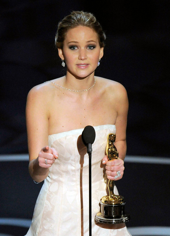 Description of . Jennifer Lawrence accepts the award for best actress in a leading role for