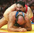 Bruce Baumgartner of the US (top) holds Zaza Turmanidze of Georgia down in their 130kg Olympic freestyle wrestling match at the Georgia World Congress Center in Atlanta, Georgia, 01 Aug. Baumgartner won 14-2. GEORGES GOBET/AFP/Getty Images