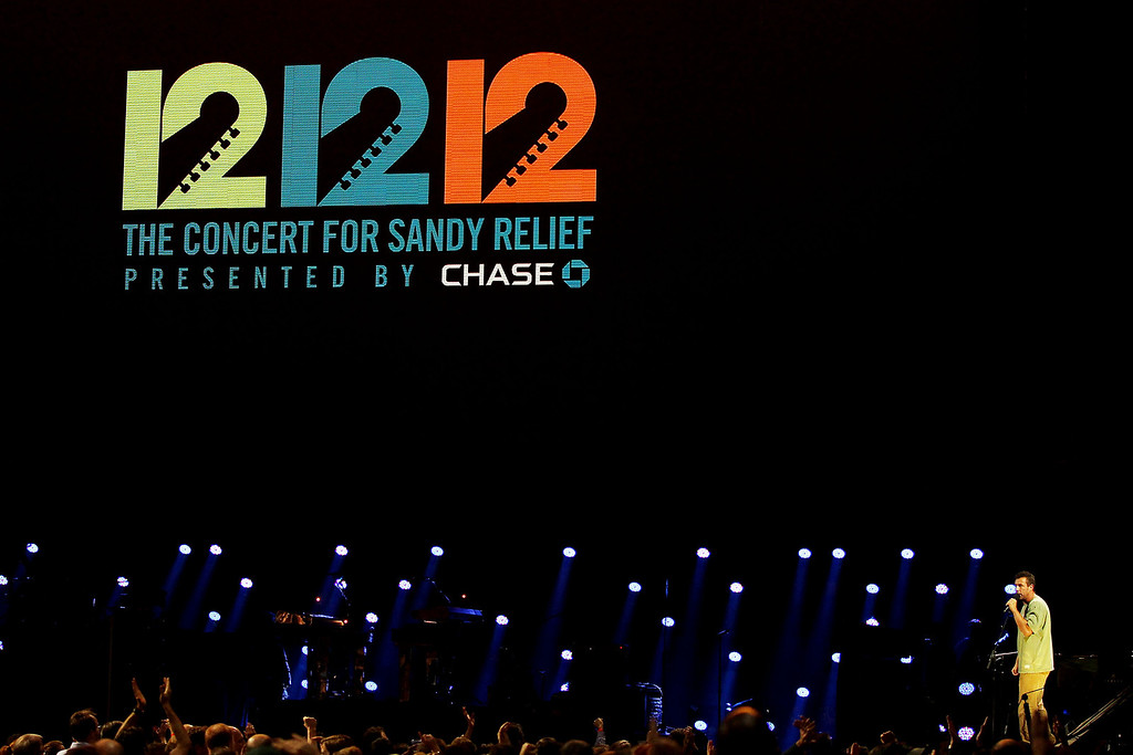 Description of . This image released by Starpix shows Adam Sandler performing at the 12-12-12 The Concert for Sandy Relief at Madison Square Garden in New York on Wednesday, Dec. 12, 2012. Proceeds from the show will be distributed through the Robin Hood Foundation. (AP Photo/Starpix, Dave Allocca)