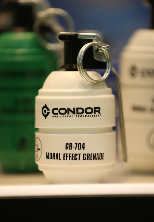 Description of . A public order 'moral effect' grenade is displayed at the Defense and Security Exhibition on September 10, 2013 in London, England.   (Photo by Peter Macdiarmid/Getty Images)