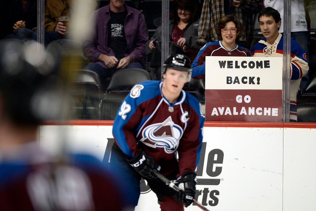 Description of . DENVER, CO. - JANUARY 22: Fans hold a sign as Colorado Avalanche left wing Gabriel Landeskog (92) skates during the pre-skate of their first home game of the NHL season. The Colorado Avalanche hosted the Los Angeles Kings at the Pepsi Center on January, 22, 2013.    (Photo By John Leyba / The Denver Post)