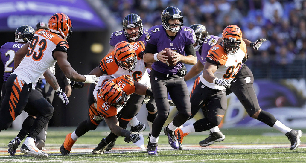 Description of . Baltimore Ravens quarterback Joe Flacco scrambles put of trouble as (L-R) Cincinnati Bengals defensive end Michael Johnson, outside linebacker Vontaze Burfict, defensive end Carlos Dunlap and outside linebacker James Harrison close in during the first half of a NFL football game against the Cincinnati Bengals in Baltimore, Sunday, Nov. 10, 2013. (AP Photo/Patrick Semansky)