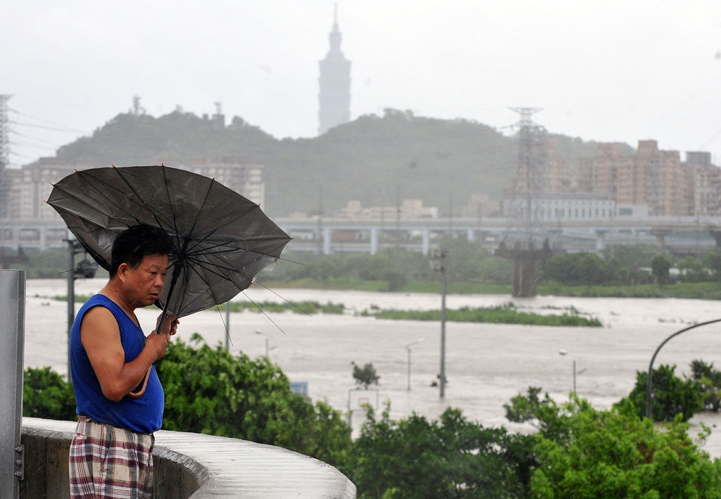 "Description of . A resident battles against strong winds caused by typhoon Soulik in Taipei on July 13, 2013.  Thousands of people were evacuated in Taiwan and the entire island declared an ""alert zone\"" as Typhoon Soulik made landfall early morning, killing one person and injuring seven. Mandy Cheng/AFP/Getty Images"