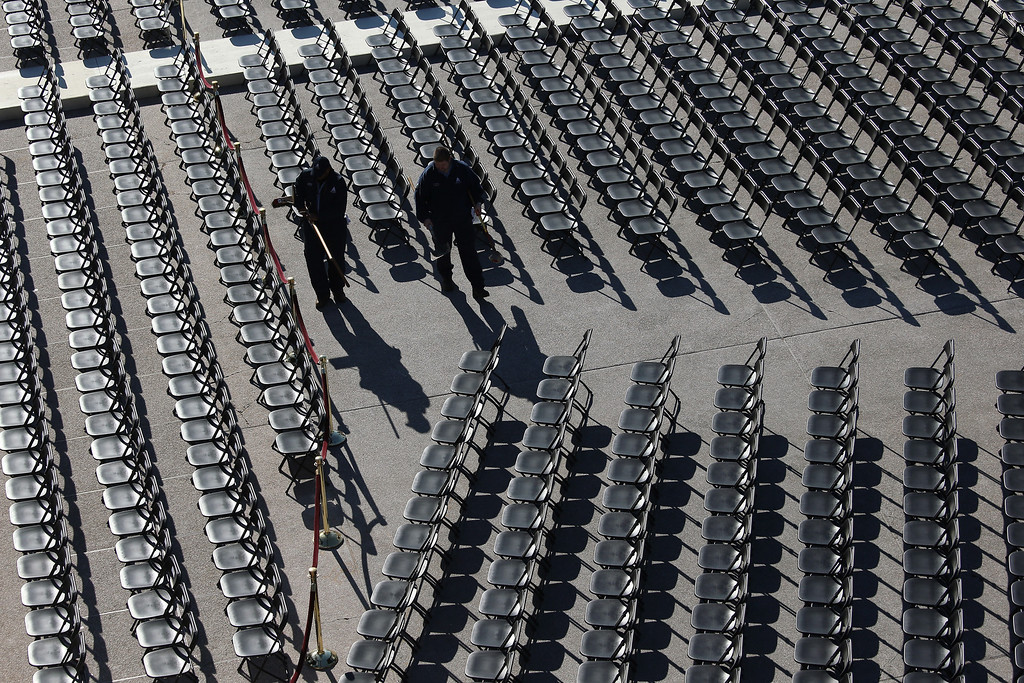 Description of . Workers clean an empty seating area at the U.S. Capitol building as Washington prepares for U.S. President Barack Obama's second inauguration on January 20, 2013 in Washington, DC. Both Obama and U.S. Vice President Joe Biden will be officially sworn in today with a public ceremony for the President taking place on January 21.  (Photo by John Moore/Getty Images)