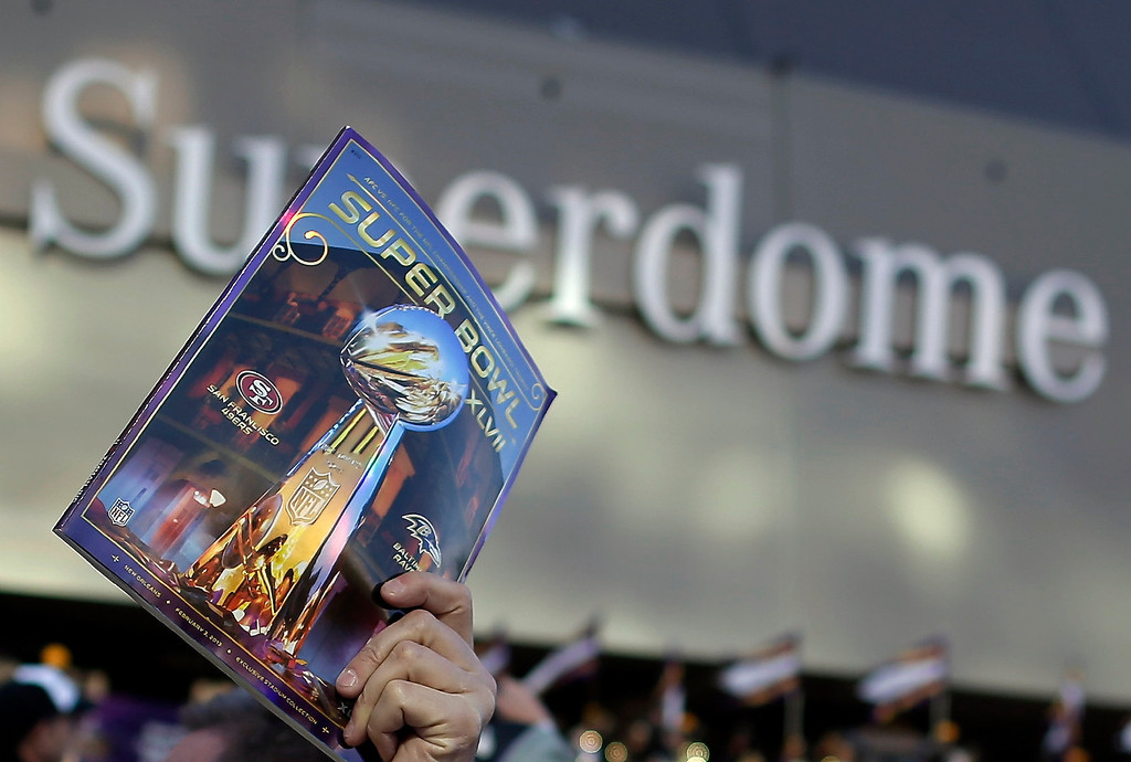 Description of . A vendor sells an official program outside the Superdome before the NFL Super Bowl XLVII football game between the San Francisco 49ers and the Baltimore Ravens Sunday, Feb. 3, 2013, in New Orleans. (AP Photo/Evan Vucci)