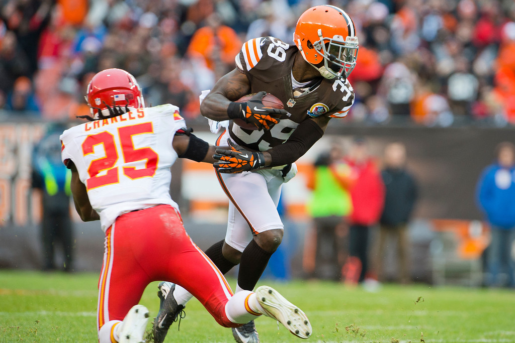 Description of . CLEVELAND, OH - DECEMBER 09: Running back Jamaal Charles #25 of the Kansas City Chiefs tries to stop free safety Tashaun Gipson #39 of the Cleveland Browns after Gipson caught an interception during the first half at Cleveland Browns Stadium on December 9, 2012 in Cleveland, Ohio. (Photo by Jason Miller/Getty Images)