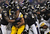 Running back Isaac Redman #33 of the Pittsburgh Steelers is pulled down by a pack of Baltimore Ravens defenders in the third quarter at M&T Bank Stadium on December 2, 2012 in Baltimore, Maryland. The Pittsburgh Steelers won, 23-20. (Photo by Patrick Smith/Getty Images)