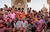 Indian Hindu devotees wait outside the Ladali or Radha temple during the Lathmar Holy festival, the legendary hometown of Radha, consort of Hindu God Krishna, in Barsana 115 kilometers ( 71 miles)  from New Delhi, India , Thursday, March 21, 2013. During Lathmar Holi the women of Barsana beat the men from Nandgaon, the hometown of Krishna, with wooden sticks in response to their teasing as they depart the town. (AP Photo/Manish Swarup)