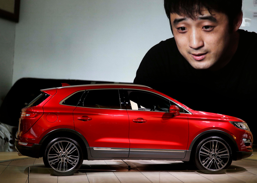 . A Lincoln MKC is displayed at the New York International Auto Show in New York, Thursday, April 17, 2014.  (AP Photo/Seth Wenig)