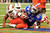 Florida Gators running back Matt Jones (R) scores a second quarter touchdown as Louisville Cardinals linebacker Champ Lee (31) looks on, during their 2013 Allstate Sugar Bowl NCAA football game in New Orleans, Louisiana January 2, 2013.  REUTERS/Sean Gardner