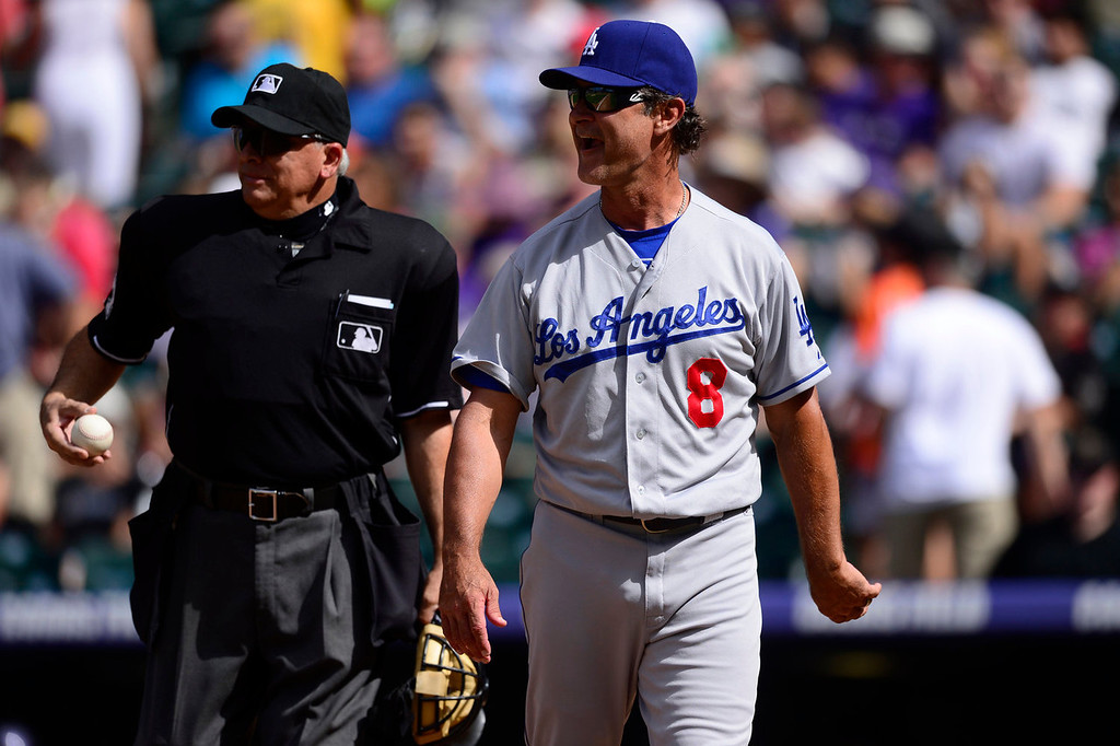 Description of . Don Mattingly (8) of the Los Angeles Dodgers argues a call with umpire Larry Vanover (27) during the action in Denver on Monday, September 2, 2013. The Colorado Rockies hosted the Los Angeles Dodgers at Coors Field.   (Photo by AAron Ontiveroz/The Denver Post)