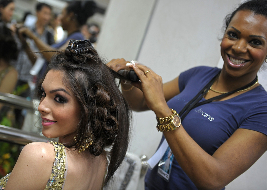 Description of . Contestant gets decorate her hair at backstage during the Miss International Queen 2013 beauty contest in Pattaya resort on November 1, 2013. Twenty-five contestants from 17 countries are to compete in Pattaya for the crown of Miss International Queen since 2004. AFP PHOTO / PORNCHAI KITTIWONGSAKUL/AFP/Getty Images