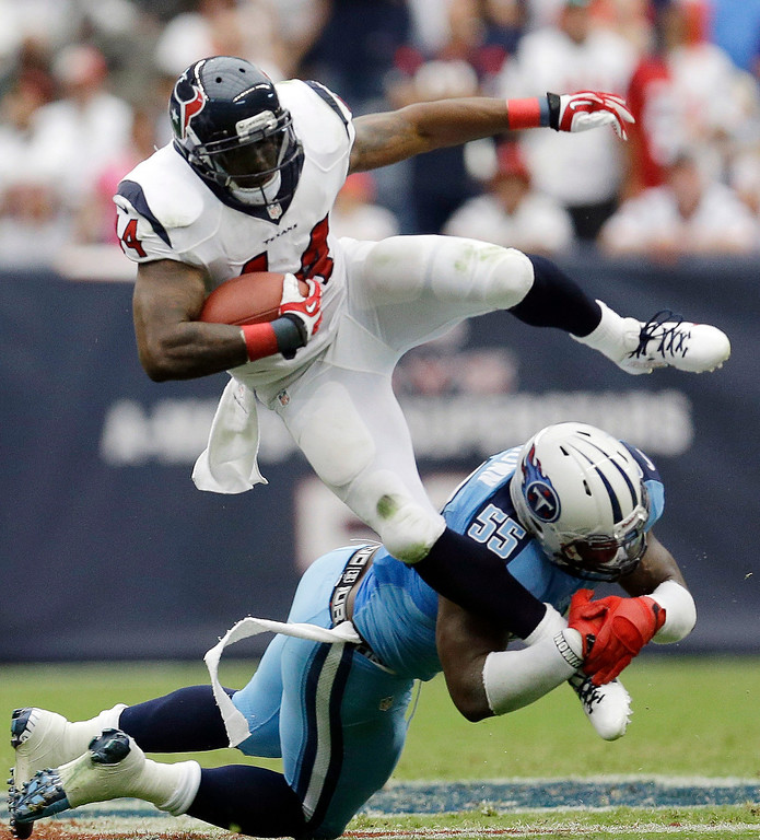 Description of . Houston Texans' Ben Tate (44) is stopped by Tennessee Titans' Zach Brown (55) during the second quarter of an NFL football game on Sunday, Sept. 15, 2013, in Houston. (AP Photo/David J. Phillip)