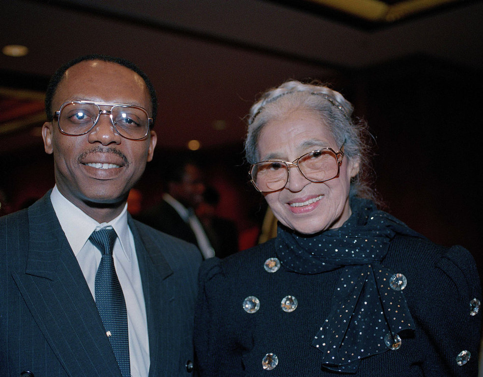 Description of . Rosa Parks, right, is seen with former Haitian president Jean Bertrand Aristide in Washington in August 1993. (AP Photo)