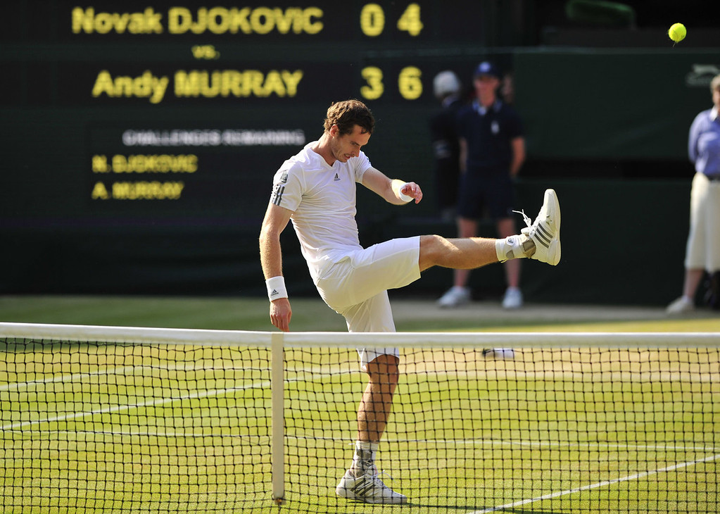 Description of . Britain's Andy Murray kicks a ball as he celebrates beating Serbia's Novak Djokovic in their men's singles final on day thirteen of the 2013 Wimbledon Championships tennis tournament at the All England Club in Wimbledon, southwest London, on July 7, 2013. Murray won 6-4, 7-5, 6-4.  GLYN KIRK/AFP/Getty Images