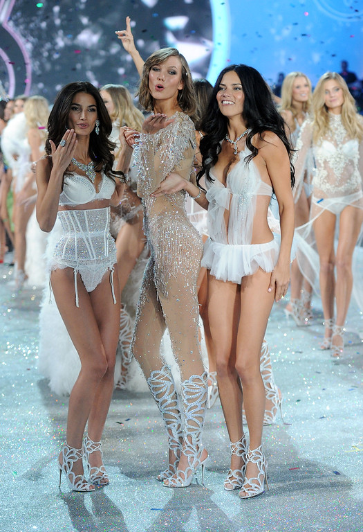 Description of . (L-R) Models Lily Aldridge, Karlie Kloss and Adriana Lima walk the runway at the 2013 Victoria's Secret Fashion Show at Lexington Avenue Armory on November 13, 2013 in New York City.  (Photo by Jamie McCarthy/Getty Images)