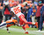 Kansas City Chiefs running back Jamaal Charles (25) is tied up by Denver Broncos free safety Rahim Moore (26) as the Denver Broncos took on the Kansas City Chiefs at Sports Authority Field at Mile High in Denver, Colorado on December 30, 2012. Tim Rasmussen, The Denver Post