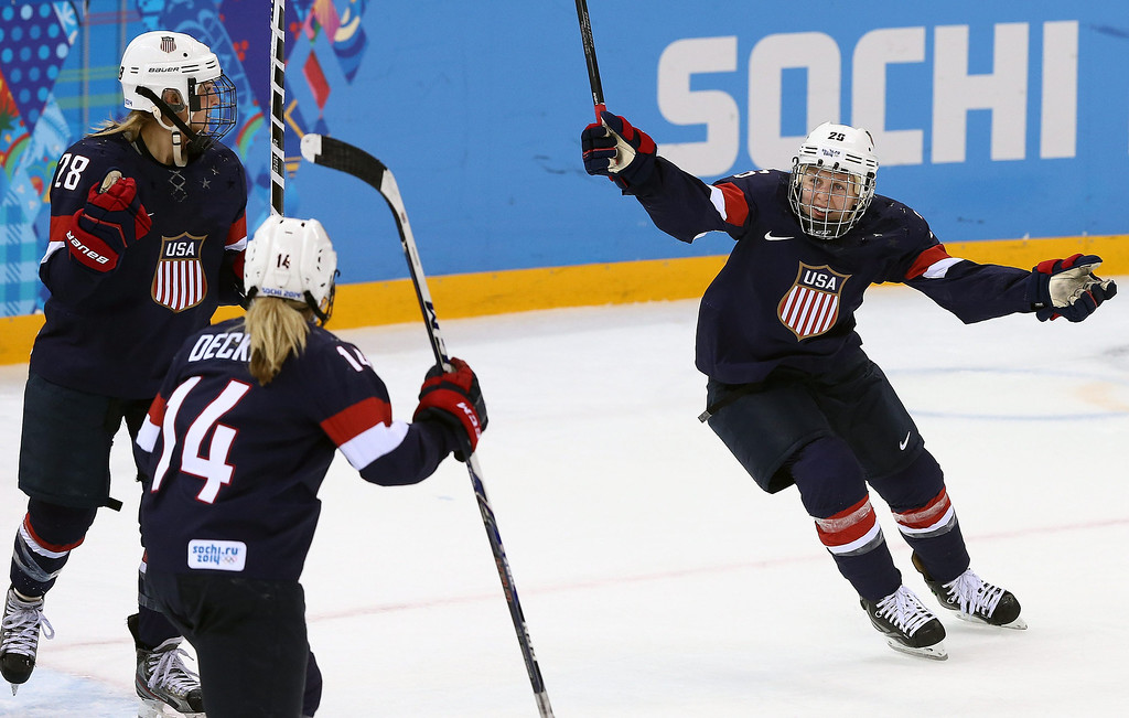 Description of . Amanda Kessel (R) of USA celebrates after Brianna Decker (2nd L) of USA scored against Sweden during their semi final match between USA and Sweden at the Shayba Arena in the women's Ice Hockey tournament at the Sochi 2014 Olympic Games, Sochi, Russia, on Feb. 17, 2014.EPA/SRDJAN SUKI