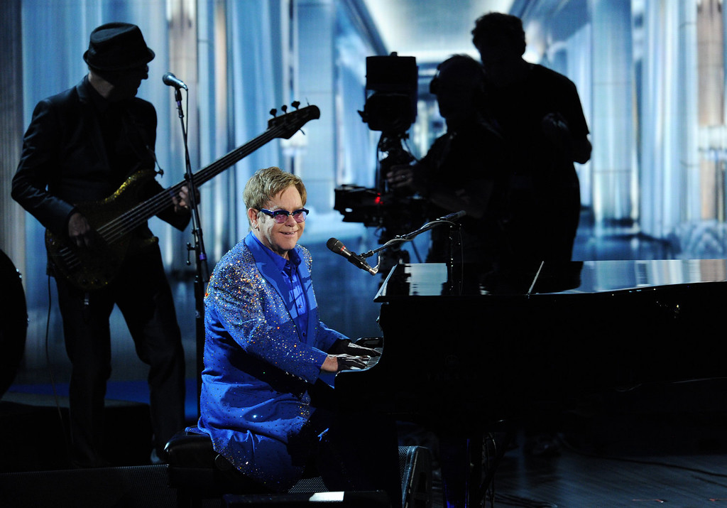 Description of . Recording artist Elton John performs onstage during the 65th Annual Primetime Emmy Awards held at Nokia Theatre L.A. Live on September 22, 2013 in Los Angeles, California.  (Photo by Kevin Winter/Getty Images)