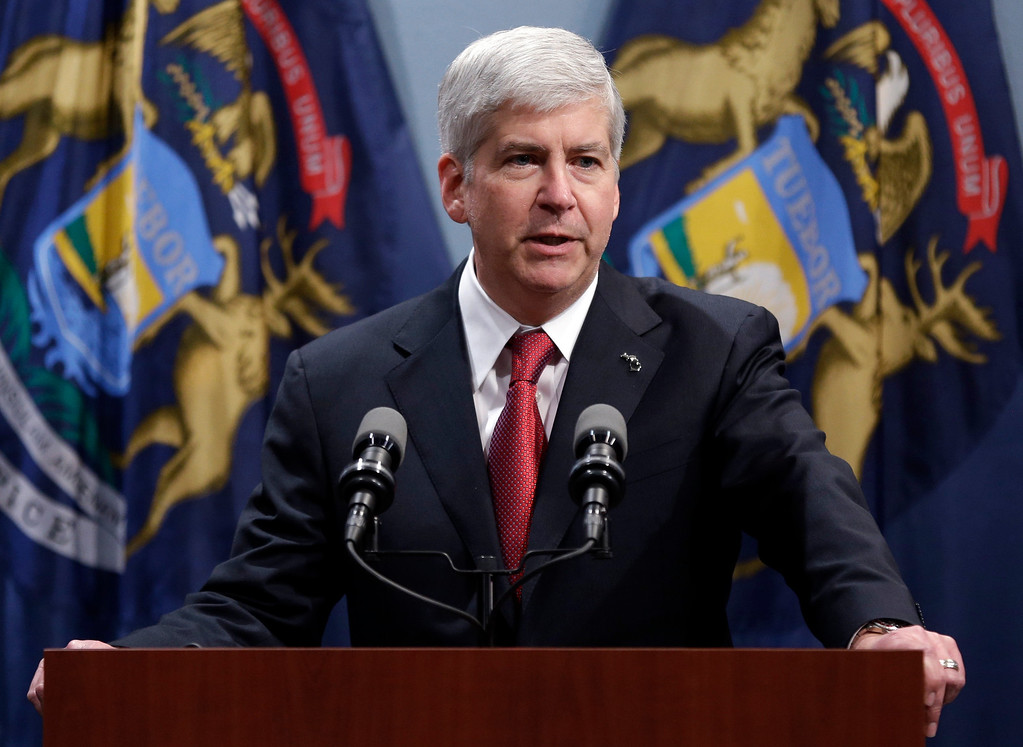 Description of . Gov. Rick Snyder speaks at a news conference in Lansing, Mich., Tuesday, Dec. 11, 2012. Michigan became the 24th state with a right-to-work law after Snyder signed the bill Tuesday. (AP Photo/Paul Sancya)