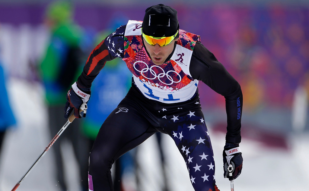 Description of . United States' Andrew Newell competes in the men's qualification of the cross-country sprint at the 2014 Winter Olympics, Tuesday, Feb. 11, 2014, in Krasnaya Polyana, Russia. (AP Photo/Gregorio Borgia)