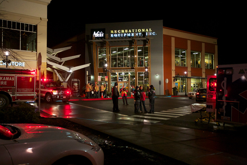Description of . Medical personnel are staged just outside Clackamas Town Center in Portland, Ore., after a shooting Tuesday, Dec. 11, 2012. A gunman is dead after opening fire in the shopping mall Tuesday, killing two people and wounding another, sheriff's deputies said. (AP Photo/The Oregonian, Thomas Boyd)