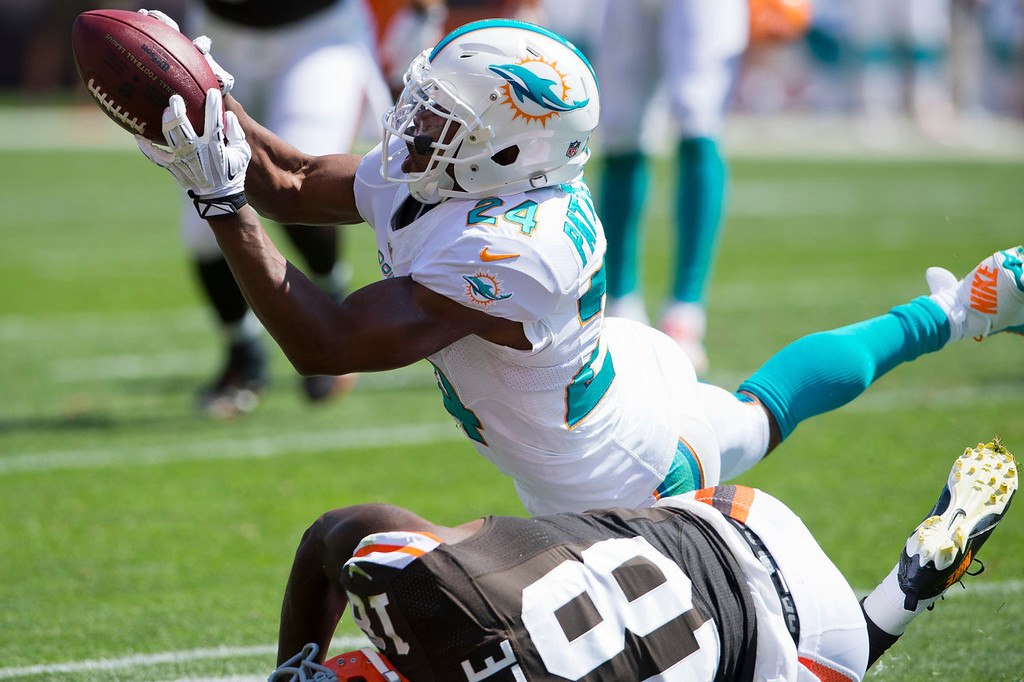 Description of . Cornerback Dimitri Patterson #24 of the Miami Dolphins hauls in an interception intended for wide receiver Greg Little #18 of the Cleveland Browns during the first half at First Energy Stadium on September 8, 2013 in Cleveland, Ohio. (Photo by Jason Miller/Getty Images)