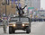 Baltimore Ravens safety Ed Reed greets fans while riding in a Humvee during the Ravens victory parade Tuesday, Feb. 5, 2013, in Baltimore. The Ravens defeated the San Francisco 49ers in NFL football's Super Bowl XLVII 34-31 on Sunday. (AP Photo/Gail Burton)