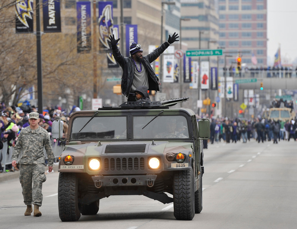 Description of . Baltimore Ravens safety Ed Reed greets fans while riding in a Humvee during the Ravens victory parade Tuesday, Feb. 5, 2013, in Baltimore. The Ravens defeated the San Francisco 49ers in NFL football's Super Bowl XLVII 34-31 on Sunday. (AP Photo/Gail Burton)
