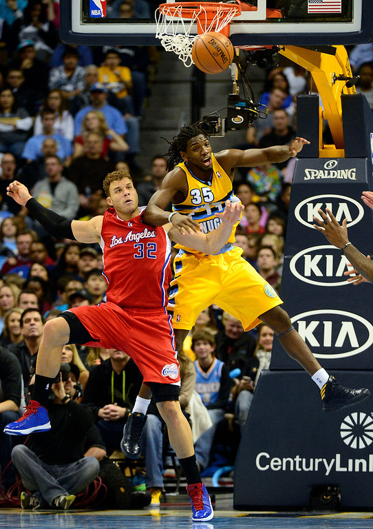 Description of . ,Denver Nuggets small forward Kenneth Faried (35) and Los Angeles Clippers power forward Blake Griffin (32) battle for position during the second half of the Nugget's 92-78 win at the Pepsi Center on Tuesday, January 1, 2013. AAron Ontiveroz, The Denver Post