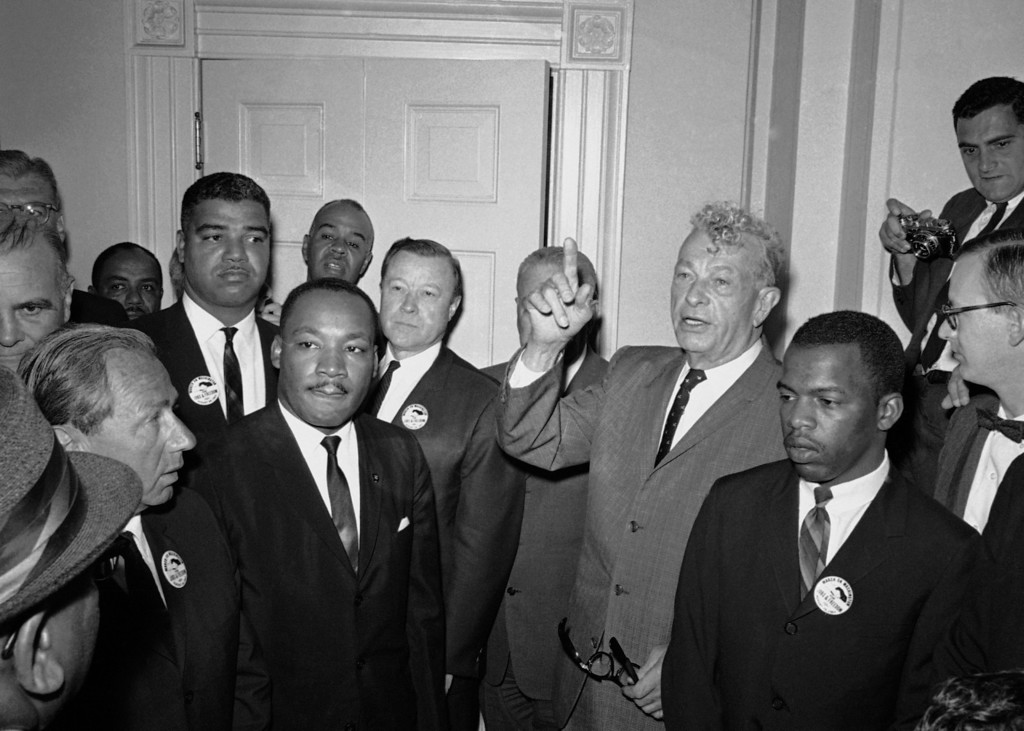 Description of . Leaders of the March on Washington shown with Senator Everett Dirksen, R-Ill., during a visit to the Capitol in Washington on August 28, 1963. From left: Whitney Young, National Urban League; Dr. Martin Luther King, Jr., Southern Christian Leadership Conference; Roy Wilkins, rear, NAACP; Walter Reuther, United Auto Workers president; and John Lewis, Student Non Violent Coordinating Committee. (AP Photo)